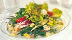 Mixed Salad on a table, Close up.